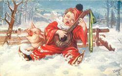 boy clown plays banjo sitting in snow leaning against pig & fence