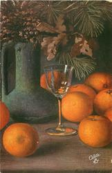several oranges on table under large vase of evergreen, oak & heather, wine glass central
