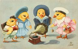 four chicks garbed as schoolchildren stand around gramophone on ground