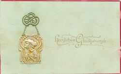 HERZLICHEN GLUCKWUNSCH  nouveau style silver medallion, showing woman looking left, hangs from ornate support, card has red margins, light green background