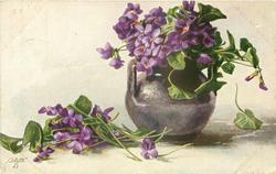 violets in grey pot with two handles