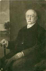 FURST OTTO VON BISMARCK, three-quarter study, seated facing left, looking front/up, wearing suite