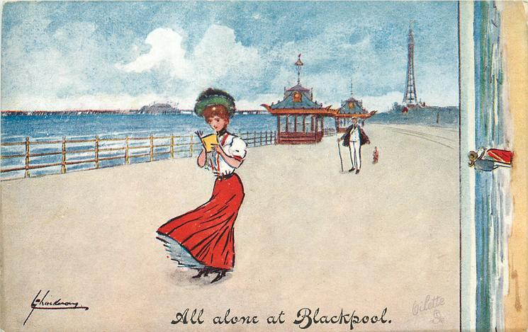 ALL ALONE AT BLACKPOOL   pretty girl stands reading on promenade, distant man walking his dog