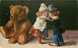 boy and girl dolls dance while teddy looks on from left