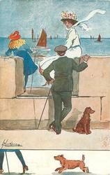 girl in white outfit sitting on edge of promenade talking to young man, young girl left faces away, brown dog below