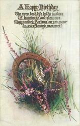 purple and white heather under upside down horseshoe