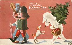 two doll people walk left in front of dog & snow person who carries Xmas tree & basket of apples