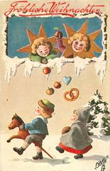 two angel puppets drop apples, heart & pretzel to two children below marching left, boy in front on hobby-horse