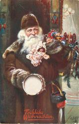 3/4 length santa in deep red robe stands & faces front, carries many toys & a drum