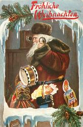 deep red coated Santa carrying many toys uses telephone, facing & looking left, framed by snow & holly