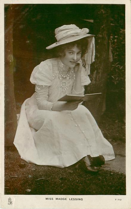 MISS MADGE LESSING seated in garden, holds open book with right hand, left hand on cheek, looks front