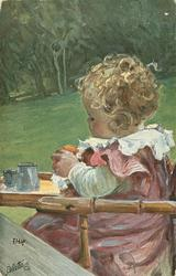 girl in high chair facing left
