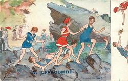 boys & girls in bathing suits clamber over the rocks