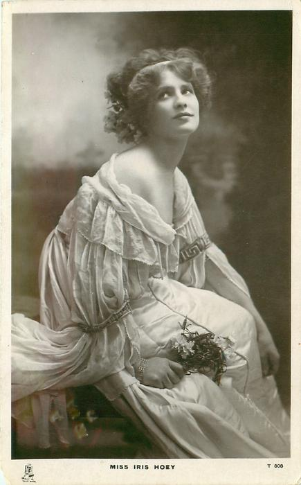 MISS IRIS HOEY  sits facing right, looking front & up