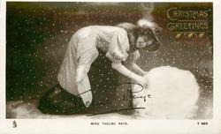 MISS THELMA RAYE  in snow making huge snowball