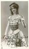 MISS OLIVE MAY  standing with baton in left hand