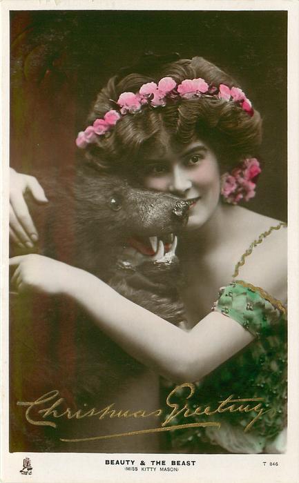 BEAUTY & THE BEAST (MISS KITTY MASON)  cuddling head of stuffed bear