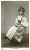 MISS MARIE WILSON  seated facing half left, looking front & up