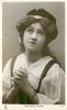MISS MARIE WILSON  chest & shoulders, hands clasped in front, looking up