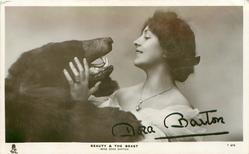 MISS DORA BARTON  BEAUTY & THE BEAST  she gazes into the open mouth of stuffed bear