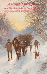 two men and dog with loaded cart in snow