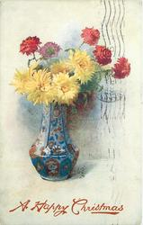 vase full of five yellow and five red mums, vase is blue with red design