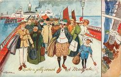 QUITE A JOLLY CROWD  large mass of contented visitors move front up promenade
