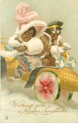 elaborately dressed black man & woman in fantasy car made of corn and melon