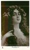 MRS. HARRY THAW (EVELYN NESBIT)  filmy dress, 2 roses in hair, faces right, looks front, hand touches hair