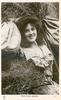 MISS HILDA ANTONY  as farm girl, lying in hay, facing half right, looking front