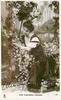 MISS ALEXANDRA CARLISLE  amongst flowers