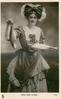 MISS JEAN AYLWIN  stands displaying fish