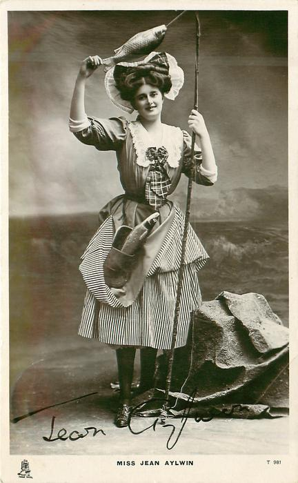 MISS JEAN AYLWIN  fishing rod & fish hanging above her head
