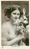 MISS JEAN AYLWIN  head & chest, sits holding large bouquet, facing partly right, looking front