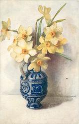 delft blue vase with handle, nine or ten daffodils in vase