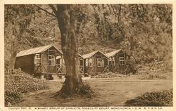 A SHADY GROUP OF CHALETS, ROSECLIFF COURT