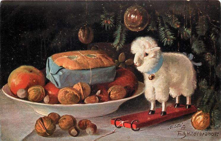 toy lamb stands beside bowl of fruit and nuts