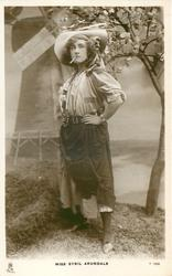 MISS SYBIL ARUNDALE  as gypsy, standing smoking, with hand on hip, facing left, looking front