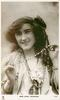 MISS SYBIL ARUNDALE  as gypsy, head & chest, holding up string of beaded