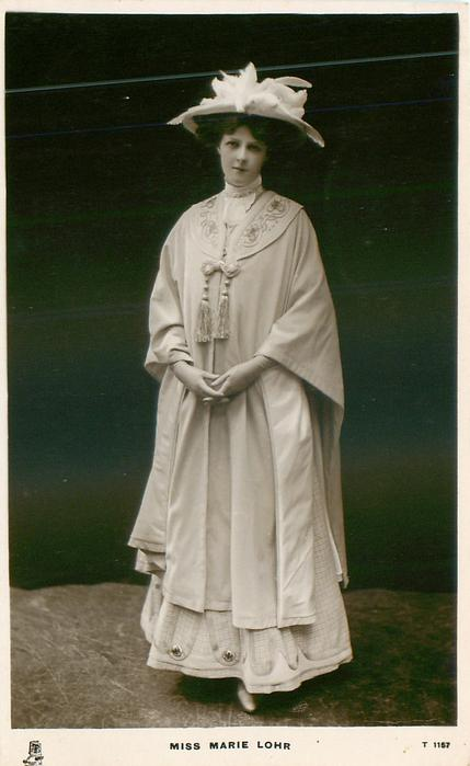MISS MARIE LOHR  stands facing & looking front