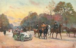 auto with driver tipping hat on left, several horseman on right