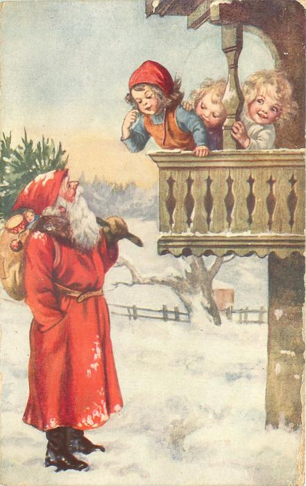 Santa stands in snow looking up at three children on balcony