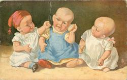 three personised baby dolls sit in a line, centre doll holds watch to ear