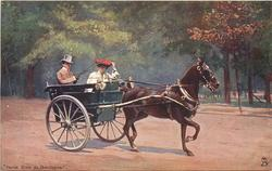 man driving two wheel trap pulled by one brown horse, lady with red hat in trap