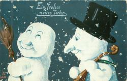 two snow people face left, one on left looks up, carries broom,one on right wears black top-hat, snow flakes falling around