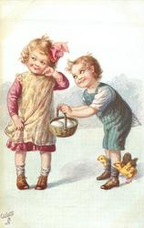 boy hold out egg basket to girl who looks coyly away, three chicks around his feet