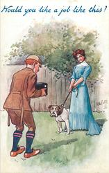 man photographing lady in blue dress who is holding bull dog on lead