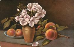 vase of flowers centre left peaches on table, two apples on plate