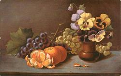 oranges, purple and green grapes on the left , yellow and purple flowers in brown vase right, one orange peeled