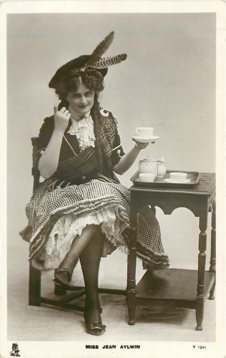 MISS JEAN AYLWIN  Scottish attire, seated taking tea
